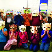 Brewster students create owl masks in Art Residency.
