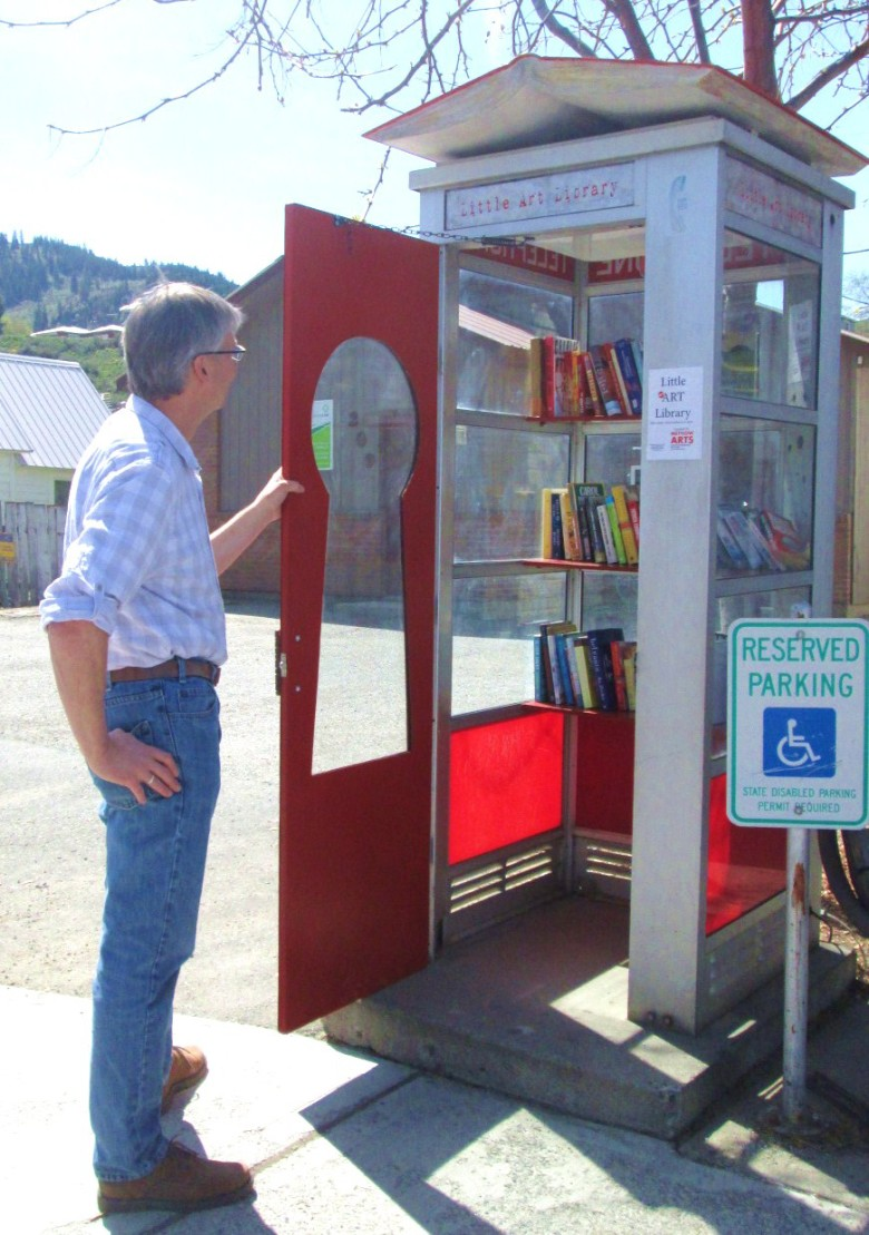 A Methow resident peruses the books