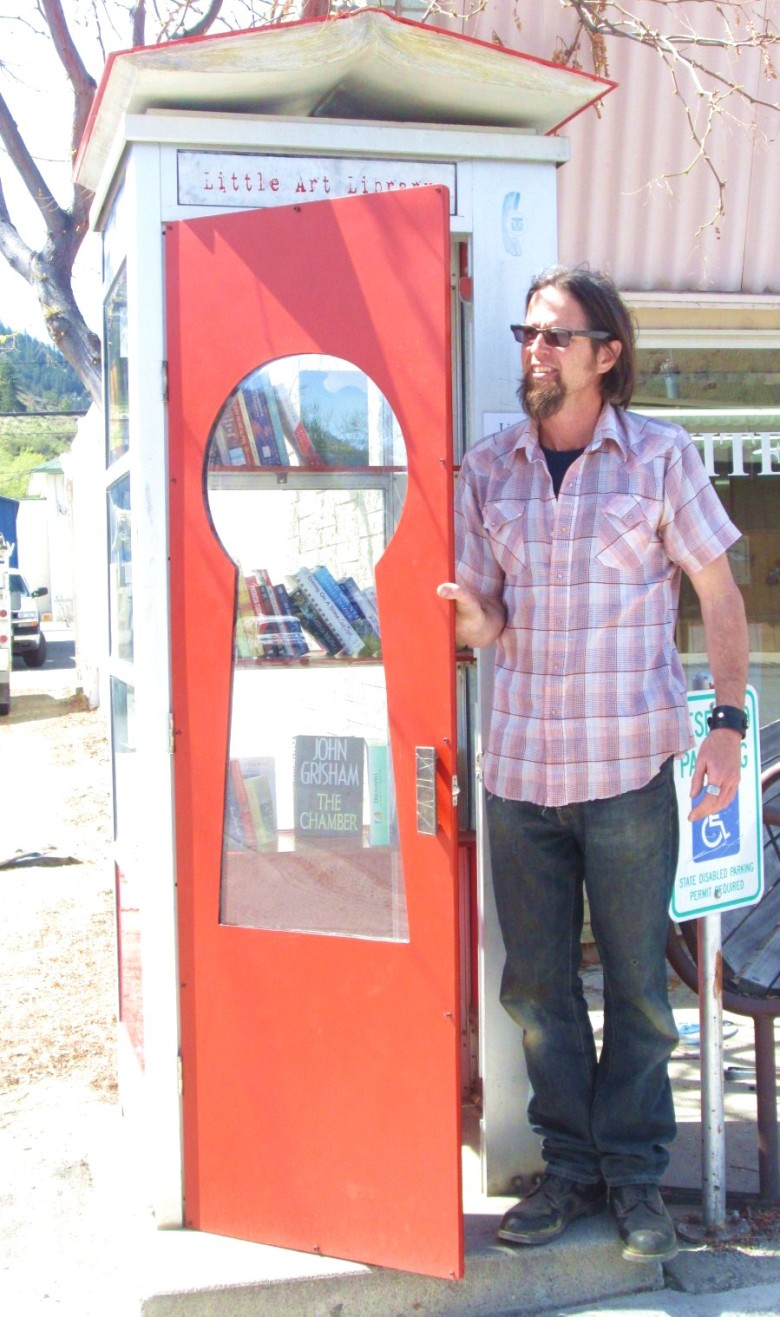 Artist Steve Ward with the Little Library he created