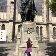 a-bach-pilgrimage-on-bicycle-beneath-the-bach-statue-at-st-thomas-kirche-in-leipzig-germany